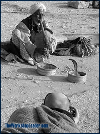 Taking a photo of a snake charmer in Sindh (Pakistan).